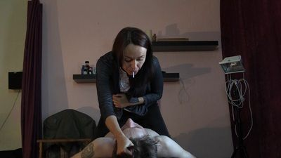 Anna spits in slave's mouth